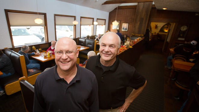 Brothers Dan and Rick Riefe, owners of Riefe's in Davenport, stand for a photo at their restaurant Tuesday, Nov. 24, 2015. The restaurant will be closing this month after 66 years in business.