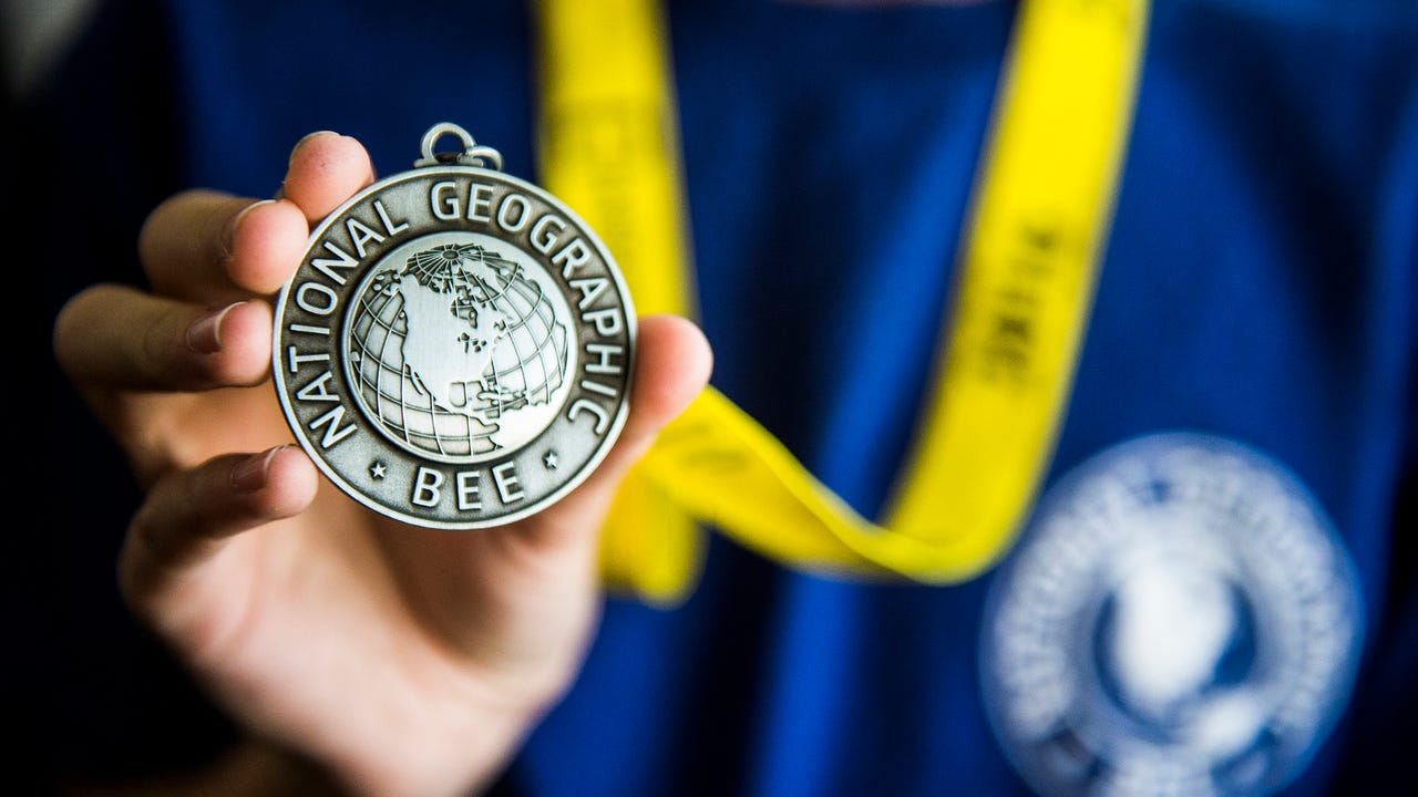 Ben Fischer, 11, a fifth grader at Vida Charter School in Gettysburg, poses for a photograph with his first place medal for winning the Pennsylvania state National Geographic GeoBee on April 1. Fischer will be representing the state of Pennsylvania in the National Geographic GeoBee competition in Washington D.C. on May 22 through the 25.