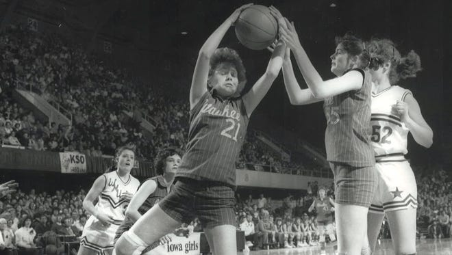 Waukee's Christy Reagan (left) and Shelly Blair battle for a rebound in the 1982 state tournament.