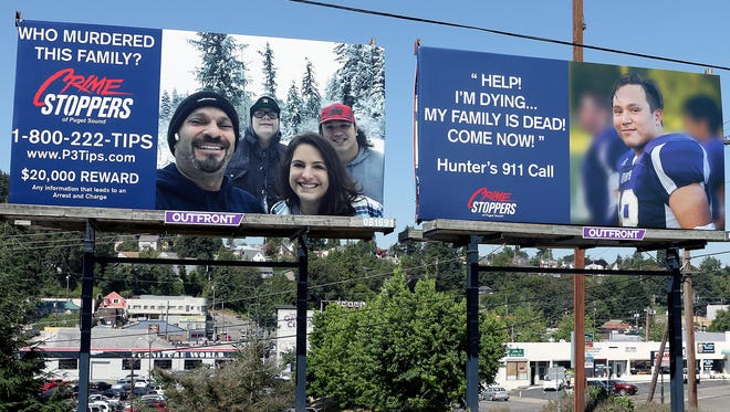 Billboards on Sixth Street in Bremerton, between Naval and Montgomery avenues, solicits information from the public about the 2017 murders of the Careaga families.