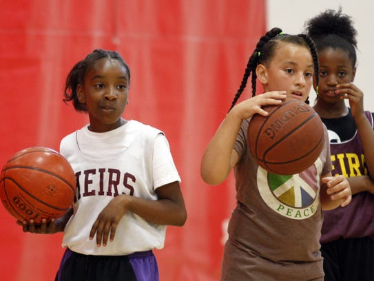 Aniya Hickman, 10, Mya Williams, 9, and Baira Williams,