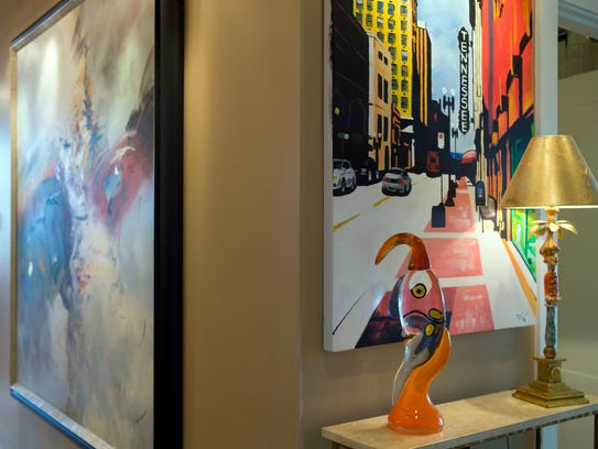 More art in the L-shaped foyer