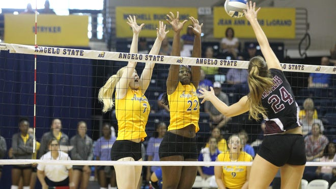 Angelo State University's Abbie Lynn (7) and Tulani Titley go up for a block against West Texas A&M during the Belles' 25-22, 25-13, 25-12  Lone Star Conference win at the Junell Center on Saturday, Sept. 23, 2017.