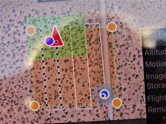 The aerial image shown on Don Gray's phone, displays not only the grid the drone is programmed to fly and photograph, but detailed information including the distance already covered, the speed the drone is flying, and the altitude it is flying.