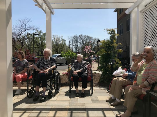 Residents at Reformed Church Home in Old Bridge enjoyed Wednesday's sunshine  in the home's Don Adams Tranquility Garden.  garden.