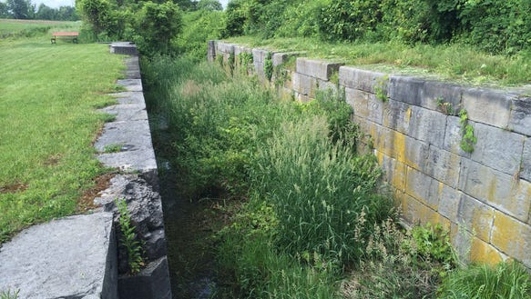 Lock 2 sits between two fields in Chili, a remnant to a bygone era. (Bill Wolcott/staff photographer)