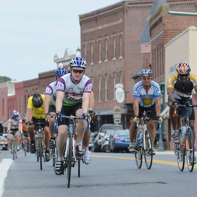 Bikers are shown in downtown Berlin competing in the