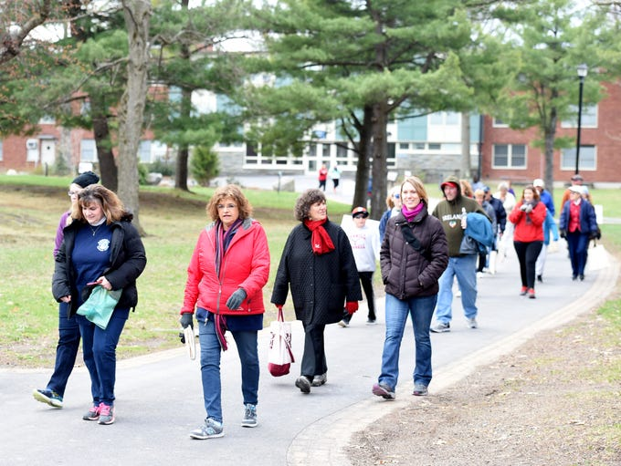 Walkers participate in the American Heart Association's