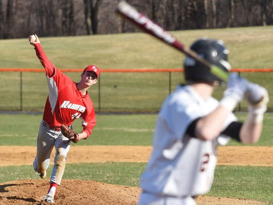 Red Hook's Austin Cole, left, winds up a pitch during Wednesday's game against Marlboro.