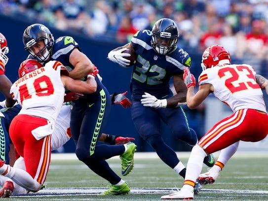Seattle Seahawks running back Chris Carson (32) rushes