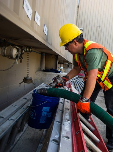 Leo Ermurachi, an employee with the bulk carrier company Gorski Bulk Transport, works on a delivery of mineral oil at the new Miller Chemical Company plant Tuesday morning in Conewago Township. The mineral oil is used as a dilutant for components in the fertilizer product produced by the company. Construction of the new plant, which is reinforced on the exterior with 8- inch thick non-combustible panels, is nearly complete and is in partial operation one year after a massive fire destroyed much of the Conewago Township business.