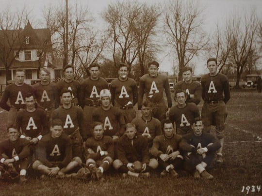The 1934 Allouez football team poses on the grounds of the Allouez school, which stood at the northwest corner of Webster and Allouez avenues, where CVS stands now.Historic Allouez Society is looking for the identities of several of the 1934 team members, so if anyone recognizes an unidentified player, email HistoricAllouezSociety@gmail.com.Pictured in the top row from left: ?, Otto Selissen, Al Wetli, ?, Ralph Huguet, ?, Harold Denissen and Eldred Wetli; in the middle row from left: Leo Christenson, Ed Denissen, Paul Selissen, ?, and Marshall Huguet; and in the bottom row from left: ?, Red Oakrusch, ?, ?, ?, and Charles Golueke.