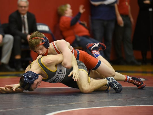 Westland John Glenn's Mikey Mars wrestles Wyandotte's Dylan Neal during a match from earlier this season.