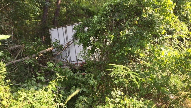 An 18-wheeler runs off Interstate 55 at the Hinds/Copiah County line Tuesday.