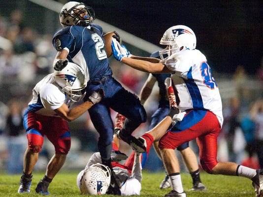 Dallastown running back Robert Catchings (2) fights for extra yardage against several New Oxford defenders last season at home. The Wildcats enter No. 2 in GameTimePA.com's YAIAA preseason rankings. New Oxford is 10th. (GAMETIMEPA.COM -- FILE)