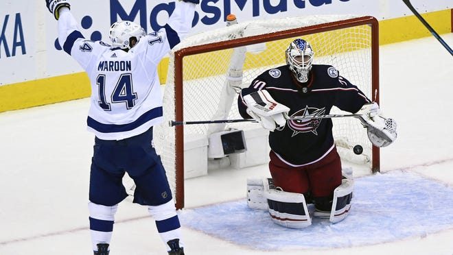 Lightning left wing Pat Maroon celebrates a second-period in front of Blue Jackets goaltender Joonas Korpisalo.