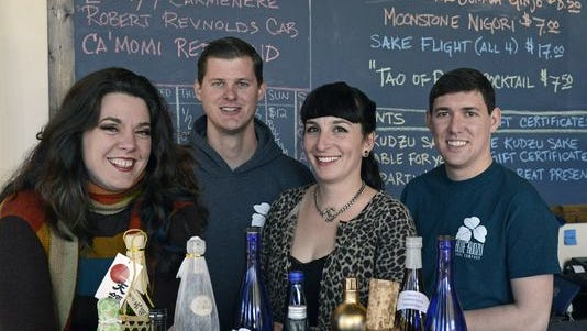 Co-owners of the River Arts District's Blue Kudzu Sake Co., from left: Cat Ford-Coates, Mitch Fortune, Mary Taylor and Preston Coleman.