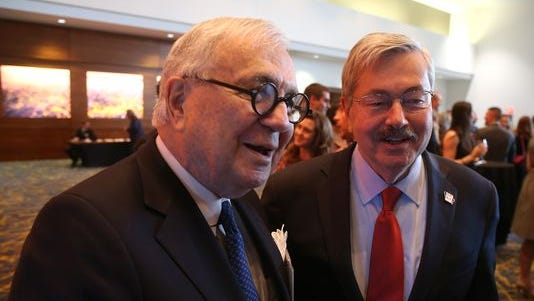 Iowa businessman John Pappajohn, shown at left with Gov. Terry Branstad at the Prometheus Awards in April, is the largest stockholder in American CareSource Holdings, a publicly traded health care firm.