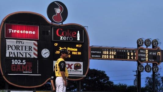 The infamous guitar scoreboard of Greer Stadium displays scores during a Nashville Sounds baseball game.