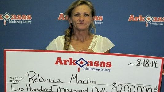 Rebecca Martin shows off her lottery check.