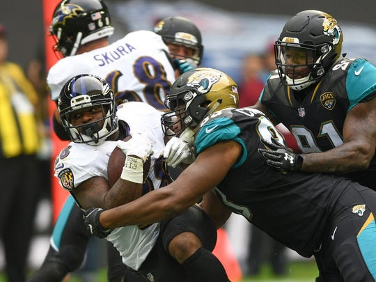 Sep 24, 2017; London, Middlesex, ENG; Baltimore Ravens running back Terrance West (28) tackled by Jacksonville Jaguars defensive end Calais Campbell (93) during the second half of the game between the Baltimore ravens at the Jacksonville Jaguars at Wembley Stadium.