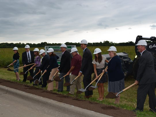 Officials attend a groundbreaking ceremony for the