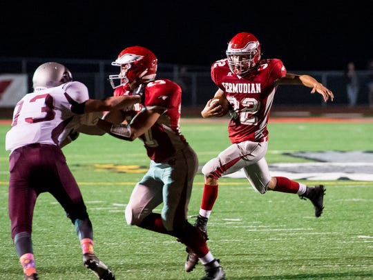 Bermudian Springs' Thomas Bross runs with the ball