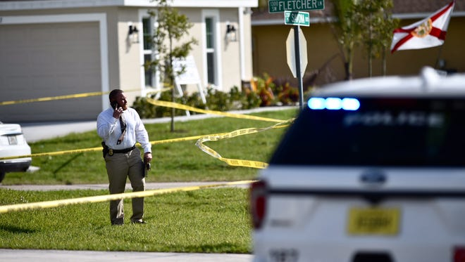 Port St. Lucie Police supervising detective, Sgt. Brint Black, works at the scene of a murder-suicide at the corner of Savona Boulevard and Fletcher Lane on Wednesday in Port St. Lucie.