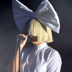 NEW YORK, NY - MAY 05:  Singer Sia (L) performs with dancers during YouTube Brandcast presented by Google at Jacob Javitz Center on May 5, 2016 in New York City.  (Photo by Taylor Hill/FilmMagic for YouTube) ORG XMIT: 633910661 ORIG FILE ID: 528531386