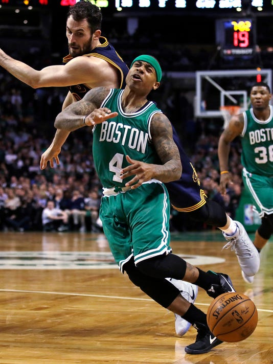 Boston Celtics guard Isaiah Thomas (4) is fouled by Cleveland Cavaliers forward Kevin Love, left, on a drive to the basket during the fourth quarter of an NBA basketball game in Boston, Wednesday, April 5, 2017. The Cavaliers defeated the Celtics 114-91. (AP Photo/Charles Krupa)