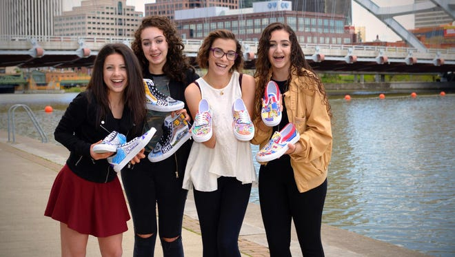 Maddie Dovi, Elaina Trapani, Julia Trapani and Isabella Barbagallo pose with their sneaker designs.