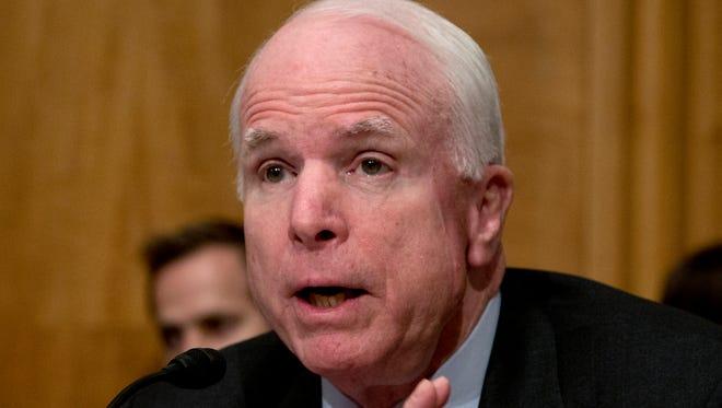 Sen. John McCain, R-Ariz. speaks on Capitol Hill in Washington, D.C., on Nov. 13, 2013.