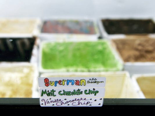 One cooler at Sarah's Creamery is dedicated to Penn State Creamery flavors; the other is filled with nontraditional flavors, such as Superman, produced at an Allentown-area creamery.