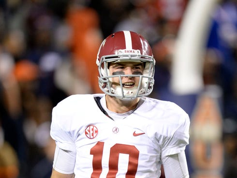 Alabama Crimson Tide quarterback AJ McCarron (10) celebrates after a 99 yard touchdown by wide receiver Amari Cooper (not pictured) against the Auburn Tigers during the fourth quarter at Jordan Hare Stadium.