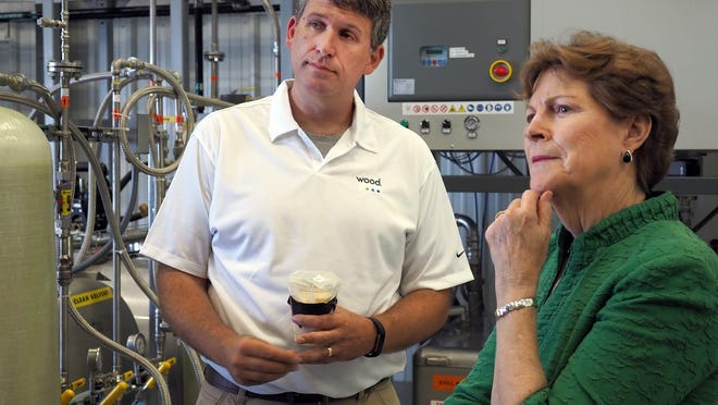 In July 2018 photo, U.S. Sen. Jeanne Shaheen tours the new Pease Site 8 treatment plant in Newington, designed to clean contaminated groundwater including PFAS, with Rob Singer, contractor and operations head for the Air Force at the new plant.