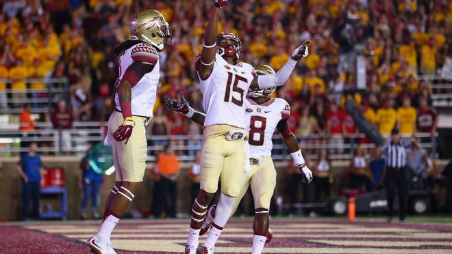 Florida State's Travis Rudolph celebrates after scoring a touchdown against Boston College last season. For the second year in a row the Seminoles will play the Eagles on a Friday night.