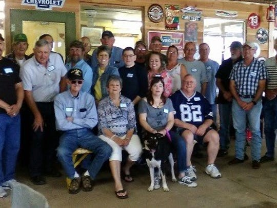 Former employees of Lockheed Martin in Abilene attend a reunion hosted by Troy and Traci Fulgham.