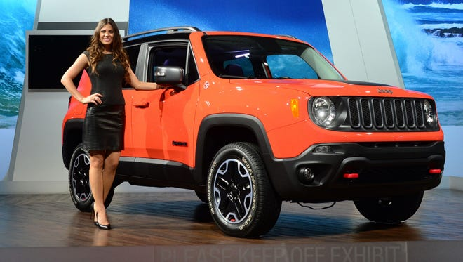 A model poses beside the all-new Jeep Renegade