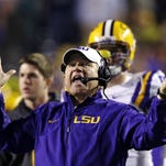 LSU coach Les Miles was reminded by school administration officials to use caution when taking to Twitter to discuss recruiting. AP FILE - In this Nov. 23, 2013, file photo, LSU head coach Les Miles reacts to a touchdown call for Texas A&M that was later overturned on replay during the second half of an NCAA college football game in Baton Rouge, La. Recruiting is the lifeline of college coaches and with teenagers using social media like Twitter to communicate, some football staffs have pushed the boundaries of NCAA regulations to reach top high school recruits. Miles was reminded by LSU administration officials to use caution when taking to Twitter to discuss recruiting. National Signing Day is Wednesday, Feb. 5. (AP Photo/Gerald Herbert, File)