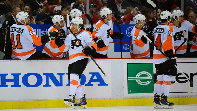 Philadelphia Flyers center Claude Giroux (28) celebrates after scoring a goal during the third period against the Detroit Red Wings at Joe Louis Arena.