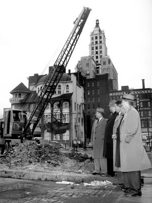 Work begins in December 1954 on the 12-floor Edway Building at Second and Jefferson, Memphis' first major office building project since 1929. Observing the ground-breaking were (from left), John R.C. Elder, vice president of Marx & Bensdorf, Inc.; Carl Hyer, architect; G.E. Bass, Jackson, Miss., contractor, R.G. Holladay, president of Marx & Bensdorf, Inc., and Wayne W. Mink of Jackson, Mississippi, executive of Edway Corp., which will own the structure. Completion is scheduled for July.