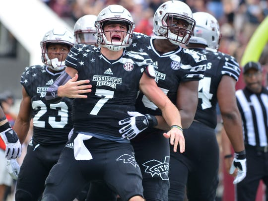 Mississippi State quarterback Nick Fitzgerald celebrates