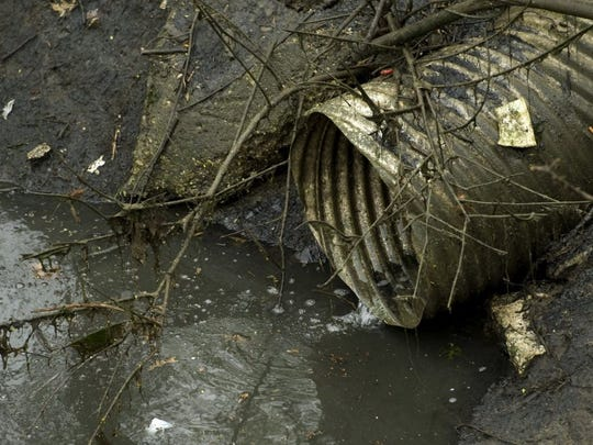 A sewer pipe drains into Bee Slough near Shawnee Drive.