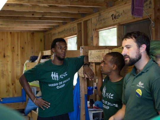 Pistons guard Ish Smith, left, at the Seeds of Peace camp in Maine. The camp is for young people from areas of conflict.
