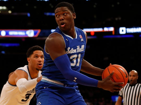 Seton Hall Angel Delgado (31) looks to pass while being defended by Villanova guard Josh Hart (3) during the Big East Tournament on Friday.