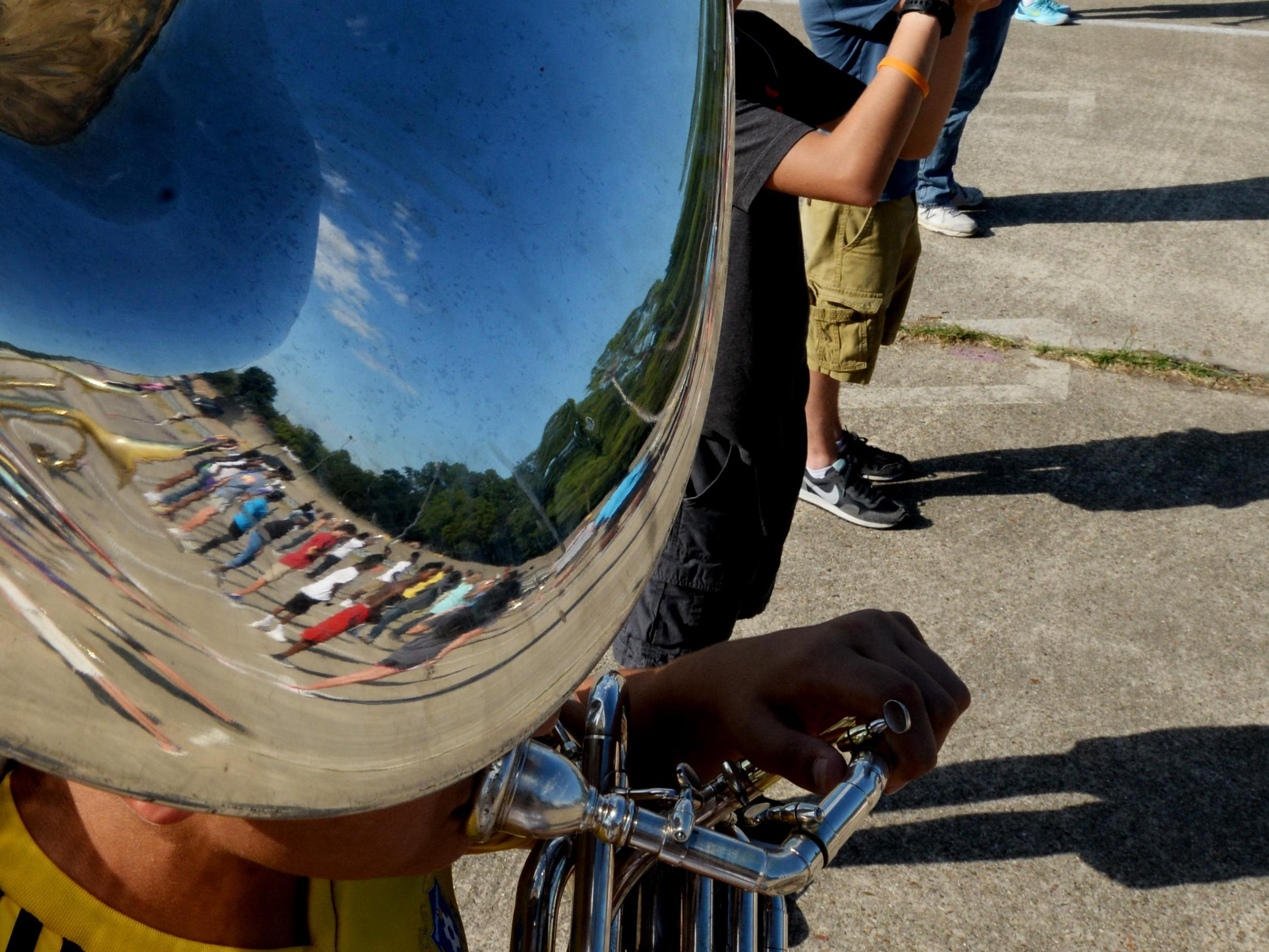 A reflection of Byrd's marching band can be seen in the sousaphone.