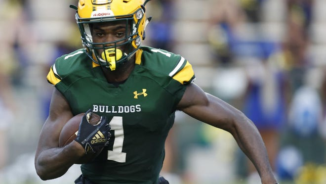 DeLand grad Dionte Marks, The News-Journal's Offensive Player of the Year in 2018, is heading to UCF instead of Ole Miss. [NEWS-JOURNAL FILE]