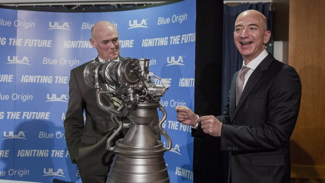 Jeff Bezos, right, CEO of Amazon and founder of Blue Origin, speaks while standing next to a model of the BE-4 rocket engine with Tory Bruno, CEO of United Launch Alliance, during a news conference in Washington, D.C., on Wednesday, Sept. 17, 2014.