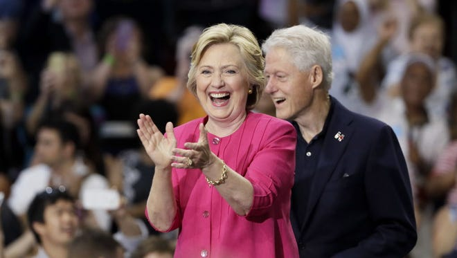 Democratic presidential candidate Hillary Clinton and her husband, former President Bill Clinton arrive for a campaign rally at Temple University, Friday, July 29, 2016, in Philadelphia.