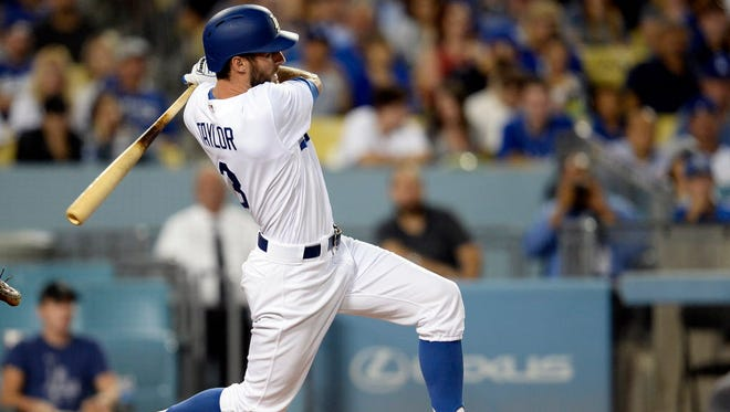 Los Angeles Dodgers left fielder Chris Taylor (3) hits a two run RBI triple in the fourth inning against the Minnesota Twins at Dodger Stadium.